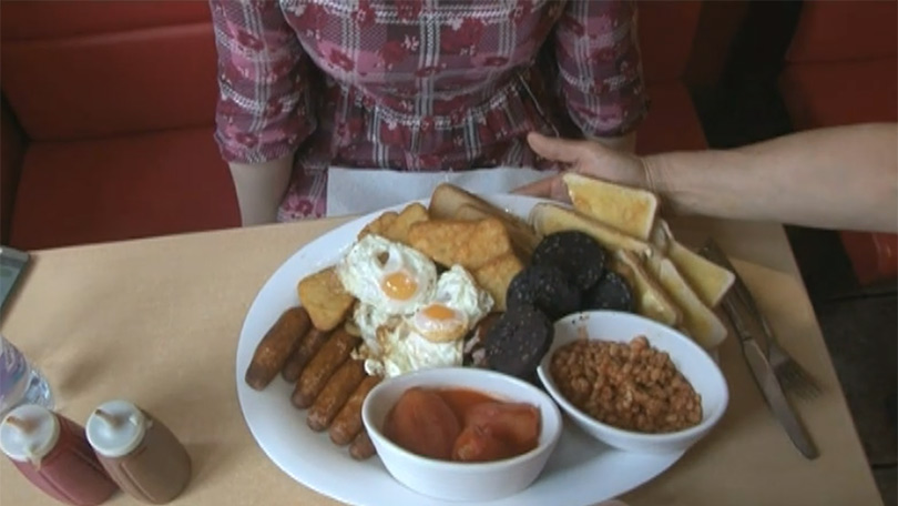Woman vs food reporter attempts to eat 5 000 calorie fry up for Cuisine 5000